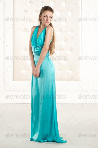 Beautiful woman in green azzure long dress