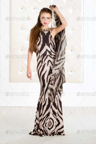 Beautiful woman in an animal print long dress