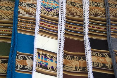 Background of colored fabrics from Bolivia ethnic market