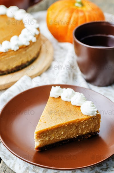 pumpkin cheesecake decorated with whipped cream