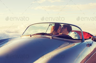 Couple Watching the Sunset in Classic Vintage Car