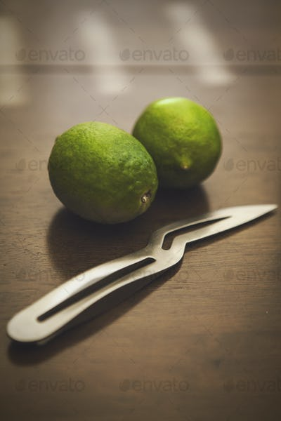 Limes and a Knife for Cocktails