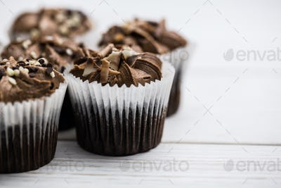 Chocolate cupcakes on a table shot in studio