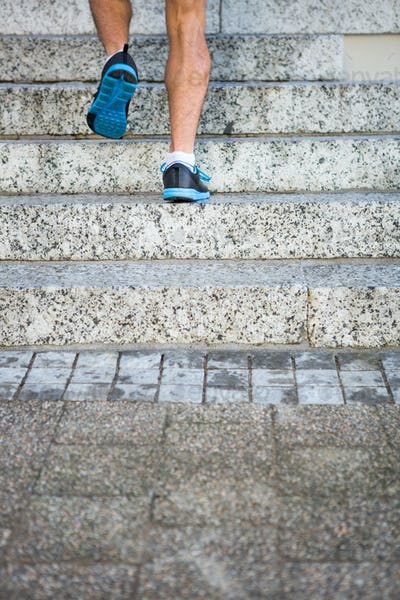 Athlete jogging up the stairs in the city