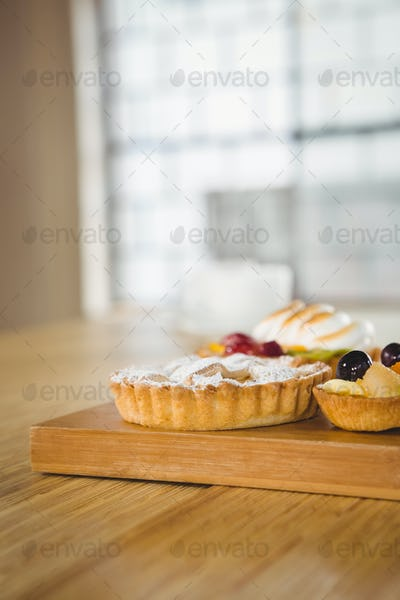 Pies on a wooden table in a cafe