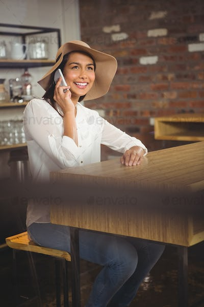 Casual businesswoman using her phones in a cafe