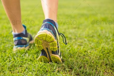 Close up view of female runners feet in parkland