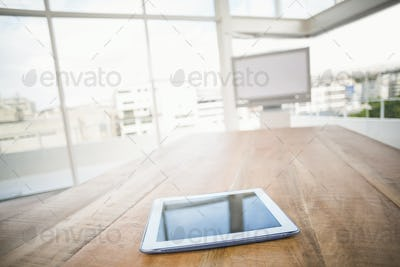 Tablet in front of meeting room in the office