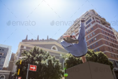 Man doing free-running in the city on a sunny day