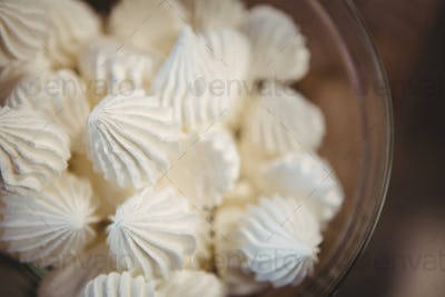 Close up view of meringues in a bowl at coffee shop