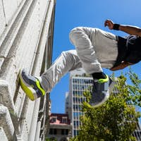 Athlete walking on the wall on a sunny day