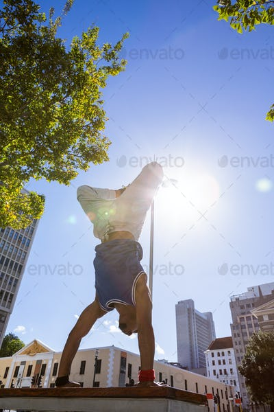 Extreme athlete jumping in the air in the city