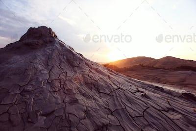 Beautiful sunset at mud volcanos in Buzau, Romania