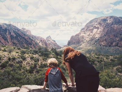 Woman and Child Looking Out at a Mountain