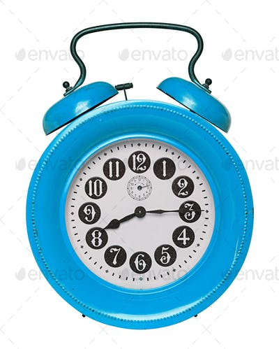 Old alarm clock isolated on white