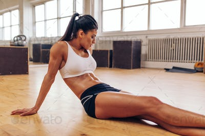 Woman relaxing after workout at gym