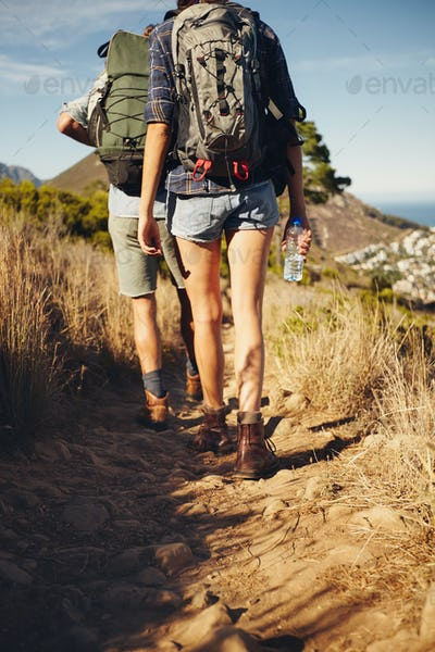 Young couple hiking together in countryside