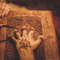 Drawing process of henna menhdi ornament on woman's hand