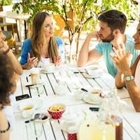 Friends enjoying meal in restaurant