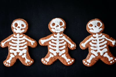 food background with cookies in the form of monsters
