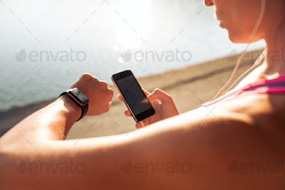 Sportswoman using smart devices