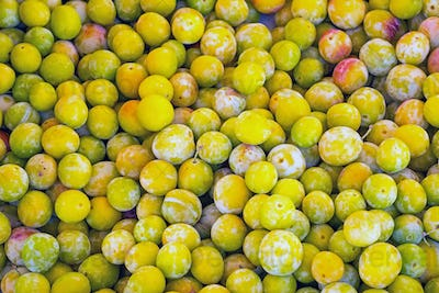 Yellow plums for sale at a market