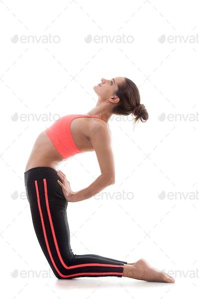Sporty girl bends backwards