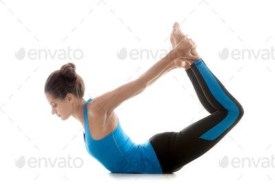 Yoga pose dhanurasana