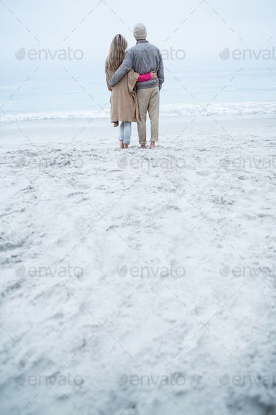 Cute couple walking together at the beach