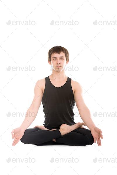 Padmasana with fingers in yogic gesture Chin Mudra