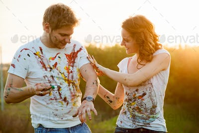Couple paint on each other