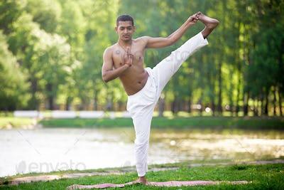 Yoga practice on riverbank