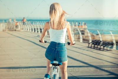 Woman riding on bicycle outdoors