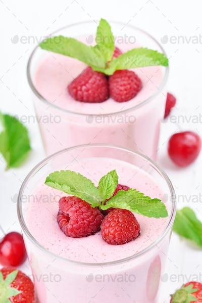 Glasses of raspberry milk shake