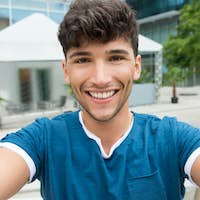 Young man takes a selfie