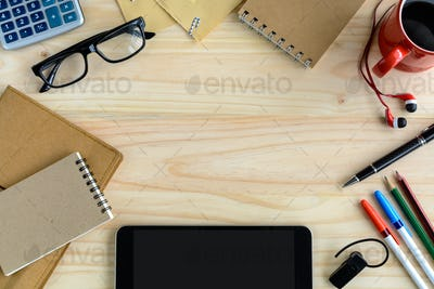 notebook with cup of coffee and office supply on desk