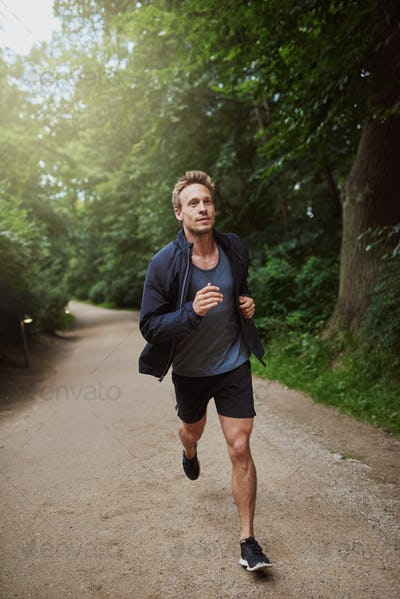 Man Jogging at the Park Early in the Morning