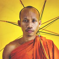 Buddhist monk holding umbrella Ceremony Concept