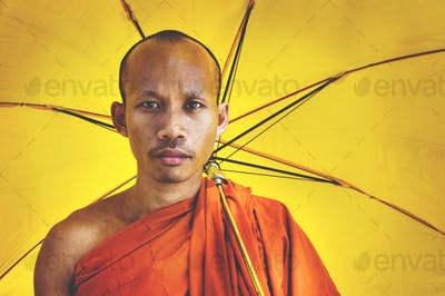 Buddhist monk holding umbrella Ceremony Concept