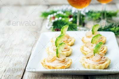 tartlets with salmon mousse, shrimp and cucumber for the New yea