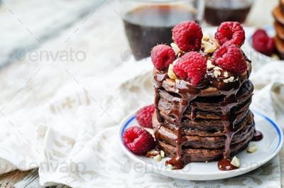 chocolate pancake with bananas, raspberies, nuts and chocolate s