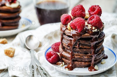 chocolate pancake with bananas, raspberries, nuts and chocolate