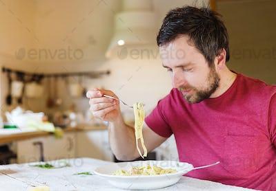 Man with tagliatelle