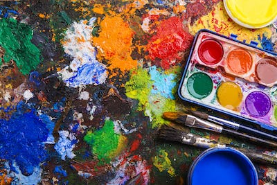 Watercolor paints and paintbrushes