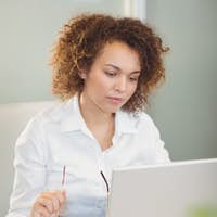 Businesswoman working in office with the help of laptop