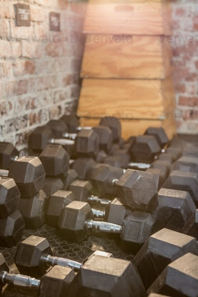 Dumbbell and plyo box stacked at the gym