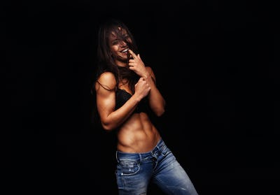Female model posing in fashionable jeans and bra