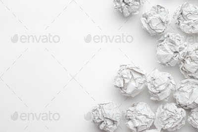 Crumpled Paper On White Table Brainstorming Concept