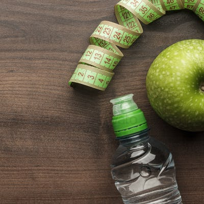 Bottle Of Water Measuring Tape And Fresh Green Apple