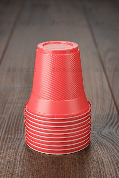 Stack Of Red Plastic Cups On The Table
